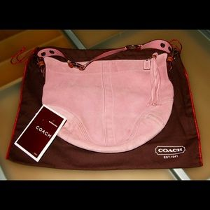 Pink suede coach purse with leather strap